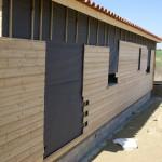 Revêtir l'extérieur d'une maison à ossature bois oui mais avec quoi ?